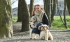 Stacey Toner, director of Moray Arts Development Engagement, with Shih Tzus Meryl and Maggie.