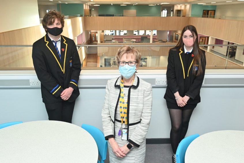 Head Prefect S6 Thomas Letch, Head Teacher Janice Simpson and Head Prefect s6 Aimee Naldrett.