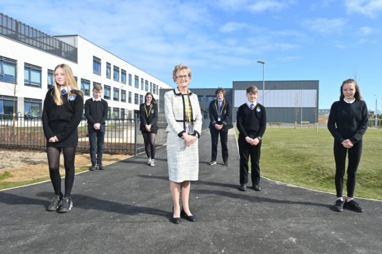Head Teacher Janice Simpson is pictured with pupils from S2 through to S6 at the New Lossiemouth High School.