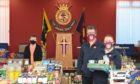 Volunteer Elizabeth Dinwoodie, Majors Bruce and Isobel Smith at the foodbank.