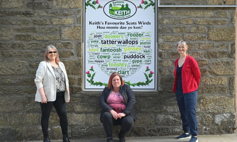 Keith's love of Doric as Scotland's only Scots toun has been celebrated with the town centre display. Pictured: Strathisla Regeneration Project chairwoman Rhona Patterson and directors Adele Williams and Linda Riggall.