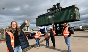 The Greyhope Bay project are finally sending off their big shipping containers away from Altens to Arbroath to be transformed into a visitor centre which will be installed at Torry Battery, where visitors will be able to sit in them and have coffee/watch the dolphins. From left, Fiona McIntyre, Greenwell Chairman Richy Turnbull, daughter and Company Director Julie Turnbull and grandson Robbie, Bryan Gray the Director at Dynamix.   08/04/21 Picture by KATH FLANNERY