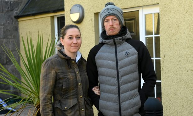 Kieren MacPhee and his partner Victoria Smith outside their city centre flat.