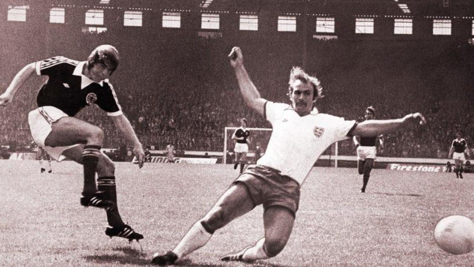 Kenny Dalgish playing against England