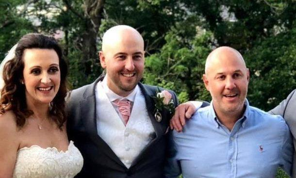 Kevin Button (centre), his wife Nicci and his brother-in-law Chris Darch