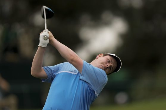 Robert MacIntyre, of Scotland, watches his tee shot on the third hole during the second round of the Masters.