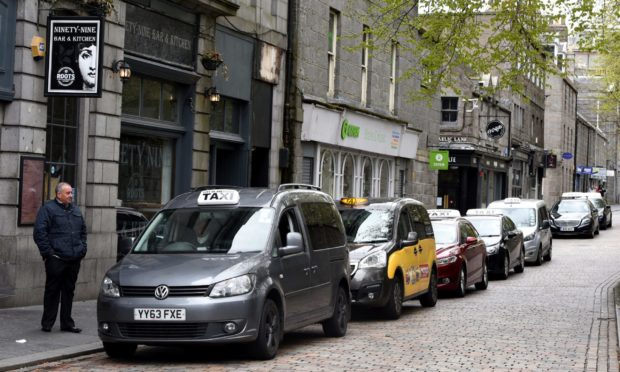 Taxis line up at the Back Wynd rank, Aberdeen, which has since been moved to make way for physical distancing measures in the city centre