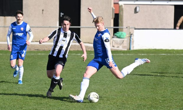 Grant Campbell, of  Fraserburgh, defends against Montrose's Russell McLean. Picture by Paul Glendell