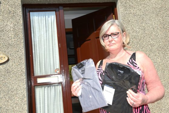 Angie Steel of Peterculter,  who has been told by Debenhams that the only way she can get the money back for the two shirts given as a Christmas present is to return them to England in person as no Scottish shops will be reopening   Picture by Paul Glendell    19/04 /2021