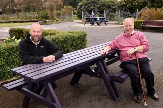 Friends of Victoria and Westburn Park Chairman Peter Stephen with Councillor Bill Cormie at Victoria Park, Westburn Road, Aberdeen. New benches formerly used as part of Spaces For People have been added to the sensory garden in the park. Pictured by Darrell Benns on 13/04/2021