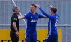 Cove Rangers players celebrate Ryan Strachan's goal against Partick Thistle.