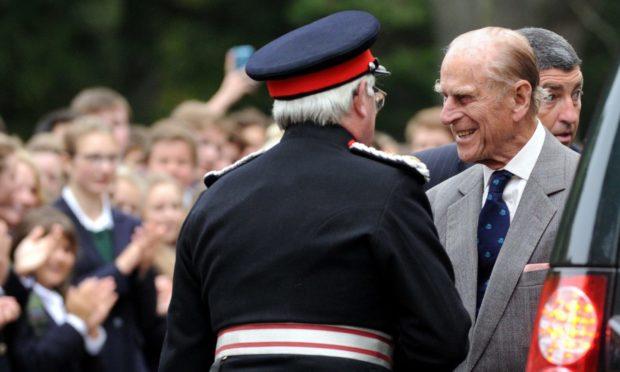 Author Grenville Johnston (left) welcomes Prince Philip to Gordonstoun School in 2014