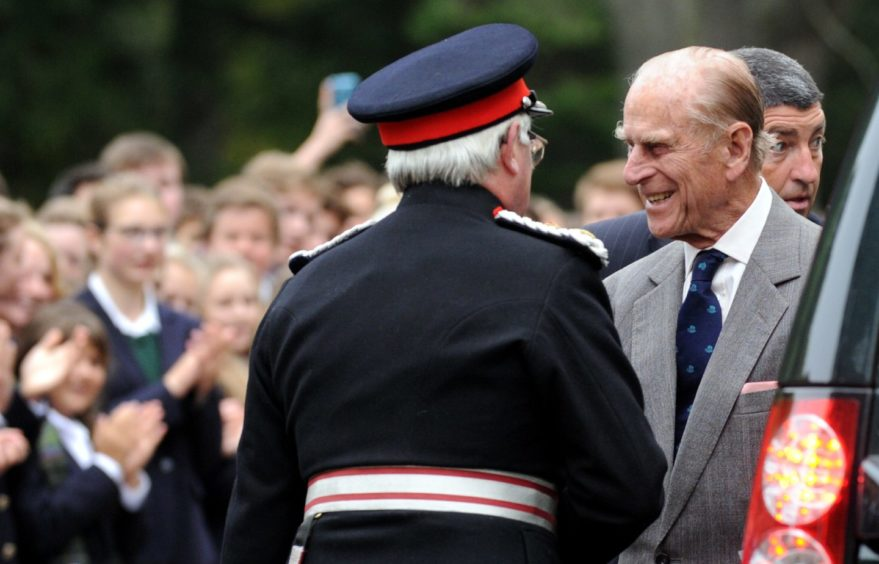 Prince Philip during a private visit to Gordonstoun, where he was a pupil, on the occasion of their 80th anniversary. The Lord of Moray, Lt Col Grenville Johnston, left, welcomes Prince Philip as he arrives. Picture by Gordon Lennox 2014