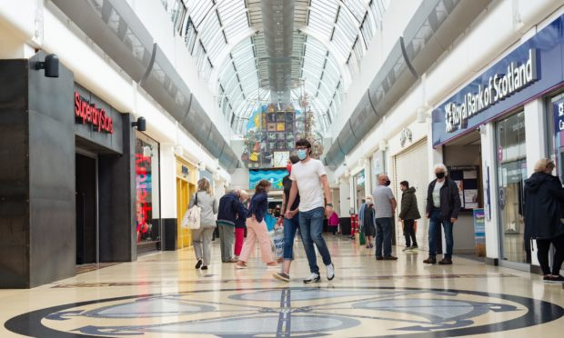 Customers at Eastgate Shopping Centre, Inverness, after shops in Scotland were able to reopen last summer.