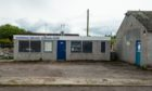 The former garage and petrol station in Hopeman would have been knocked down in the development.