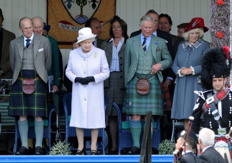 Braemar Highland Gathering 2012.Picture of (L-R) Prince Philip (Duke of Edinburgh), the Queen, Prince Charles and Camilla (Duchess of Cornwall).Picture by KENNY ELRICK       01/09/2012   .