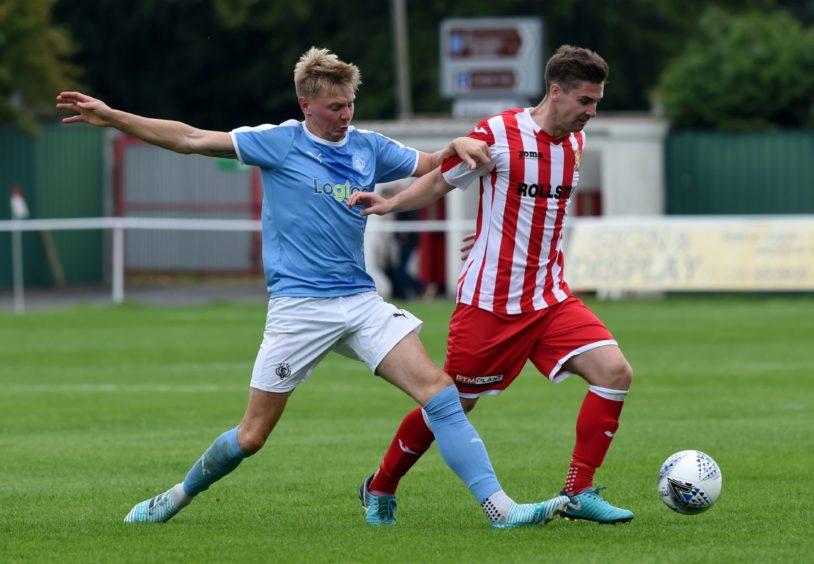 Nairn's Adam Porritt and Formartine United's Graeme Rodger.