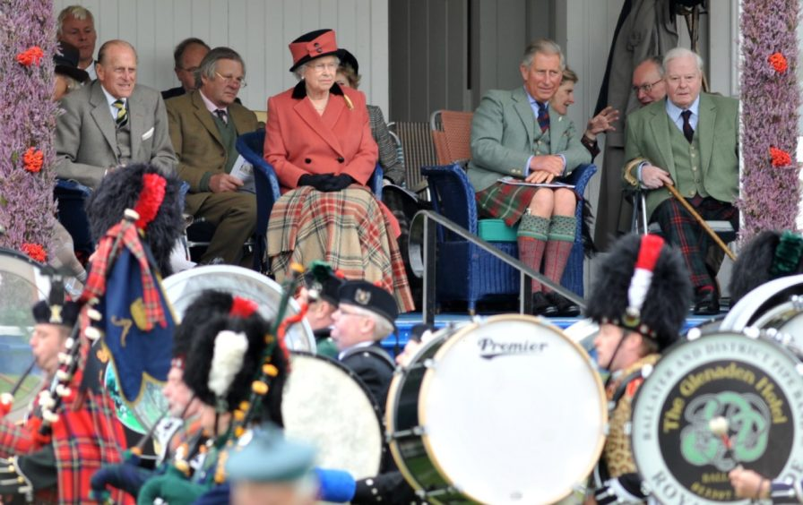 Braemar Highland Gathering 2008.   Pictured - The Queen with Prince Philip and Prince Charles watch the events at the games.  -  Picture by KAMI THOMSON          .06-09-08