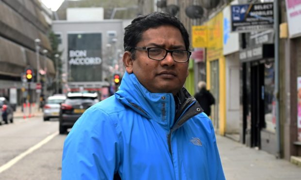 Ahashan Habib, manager of Aberdeen Multicultural Centre, in George Street - where traders were recently shaken by the news John Lewis would close