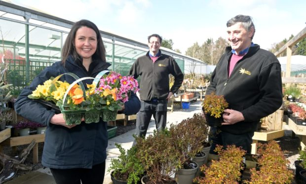 Heidi Bisset, Sandy Munro and Colin Munro, all partners at Munro's Nurseries, are delighted to be open again.