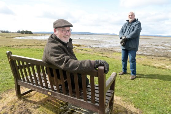 Jock Mitchell, foreground, chairman of Inver and District community council, with secretary Barry Brice in Inver Bay celebrating the award of funds for new seating