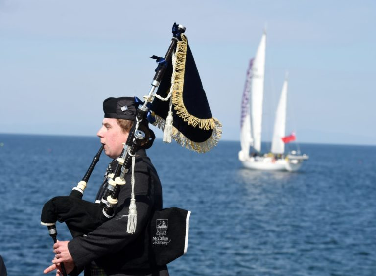 A piper played at Hopeman Harbour while a wreath was laid at sea to remember Prince Philip.