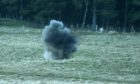 Bomb disposal officers blow up explosive