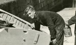 Prince Philip doing boat maintenance at Hopeman Harbour while a Gordonstoun pupil.