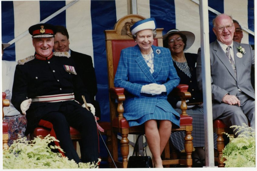 """23.06.1992 - """"Press and Journal photographer Jim Love captures a moment that was a right royal laugh as the Queen gave her seal of approval to Fraserburgh's 400th anniversary celebrations yesterday."""