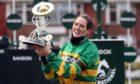 Jockey Rachael Blackmore receives the Randox Grand National Handicap Chase trophy.