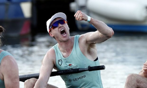 Ben Dyer celebrates after winning the Boat Race with Cambridge.