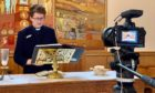 Rev Maggie McArthur minister of Cardross Parish Church in Dunbartonshire, records an online service.