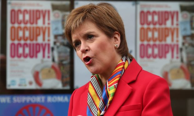First Minister Nicola Sturgeon. Today night time venues launched a legal challenge against the government's hospitality rules.