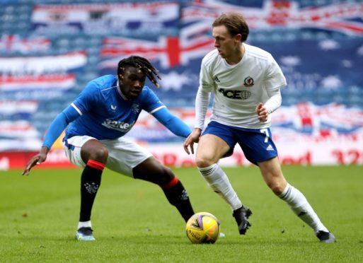 Cove Rangers' midfielder Broque Watson up against Calvin Bassey of Rangers.