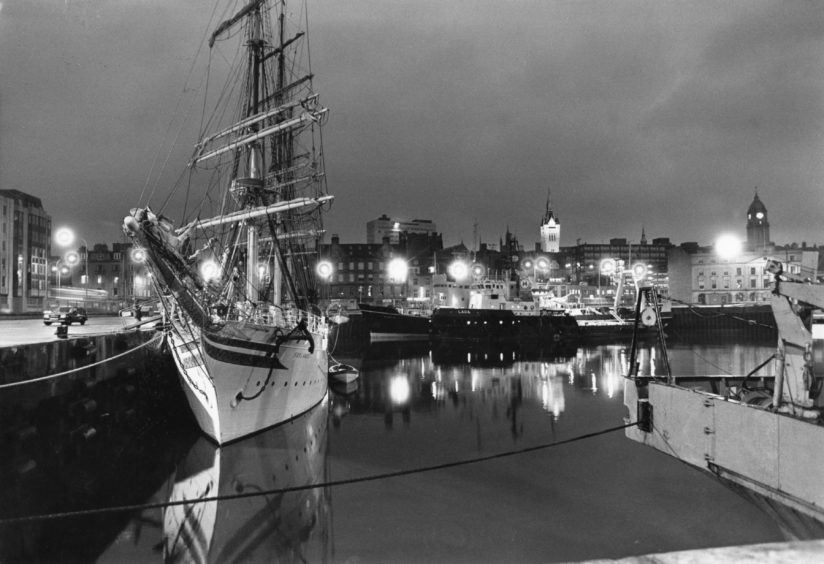 """29.08.1987 """"The high masts of the Norwegian sail training ship Sorlandet soar into the night sky of Aberdeen, contrasting oddly with the bulk of the commercial sleet berthed in the background..."""" Photograph by Jim Love"""