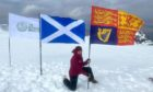 The Royal Standard and Scottish and Outward Bound Trust flags are flown on top of Ben Nevis  in tribute to the Duke of Edinburg