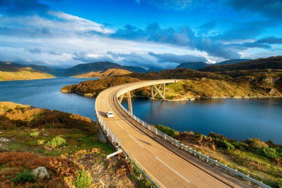 The Kylesku Bridge spanning Loch a' Chàirn Bhàin in the Scottish Highlands and a landmark on the North Coast 500 tourist driving route; Shutterstock ID 1514303708; Job: Farming; 4692307b-4f0e-4a49-92f1-d63e45ac404f
