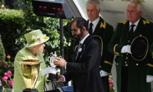The Queen presents the sheikh with a trophy after his horse won the Diamond Jubilee Stakes at Royal Ascot in 2019.