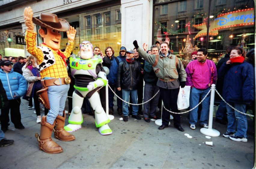 Mandatory Credit: Photo by Alex Lentati/Evening Standard/Shutterstock (2071132a) Christmas Shopping Crowds Waiting To Buy Buzz Lightyear Toy At The Disney Shop. Christmas Shopping Crowds Waiting To Buy Buzz Lightyear Toy At The Disney Shop.
