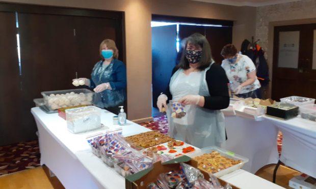 Volunteers preparing  afternoon teas to raise money for charity