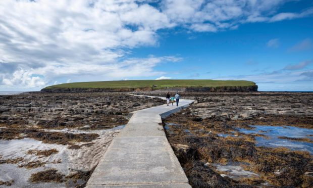 Pedestrian path at low tide to the tidal island Brough of Birsay, close to the St Magnus Way