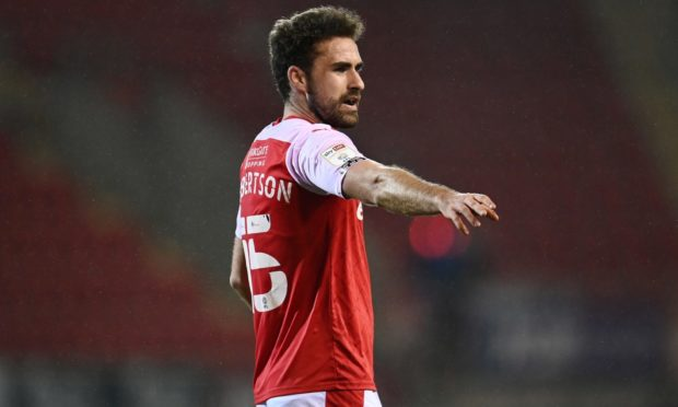 Rotherham United defender Clark Robertson has been linked with a Dons return.