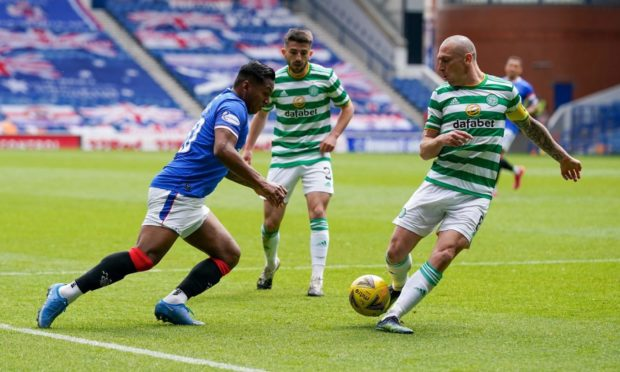 Alfredo Morelos of Rangers tries to get past Scott Brown of Celtic during Sunday's Glasgow derby.