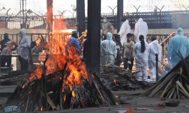 Makeshift funeral pyres are being built in parks as India's crematoriums simply cannot handle the increased number of deaths