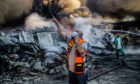 Crews of the Palestinian Civil Defence work at extinguishing a fire engulfing an agrochemical factory following an Israeli bombardment in Beit Lahia, in the northern Gaza Strip. Picture courtesy of Shutterstock.