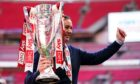 Morecambe boss Derek Adams with the League Two play-off trophy.