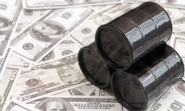 Barrels of oil against the background of American dollars. Sale of oil. Oil market.; Shutterstock ID 1295630341; Purchase Order: -