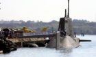 Emergency services surround the HMS Astute in 2011 after a shooting on board