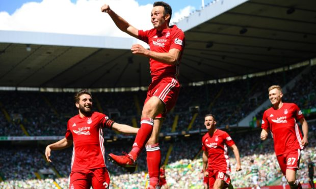 Aberdeen's Andrew Considine celebrates scoring the winner at Celtic in May 2018.