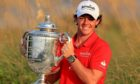 Rory McIlroy holds up the Wanamaker Trophy after winning the 94th PGA Championship at the Ocean Course in 2012.